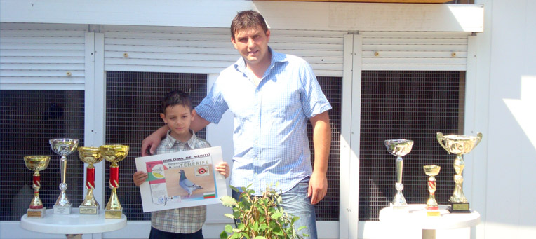 Masrian Paskov with his son and his insignias of honour from sport pigeons racings
